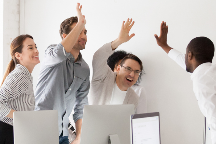 Happy diverse workmates giving high five celebrating corporate success feels excited in workplace, succeed common goal career growth concept, banner for website header design with copy space for text